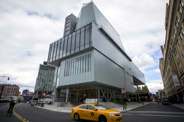 A taxi cab passes by the new Whitney Museum of American Art in New York April 23, 2015. American art gets a new home as the Whitney Museum of American Art opens the doors to its new location in New York. REUTERS/Brendan McDermid  - RTX1A1L6