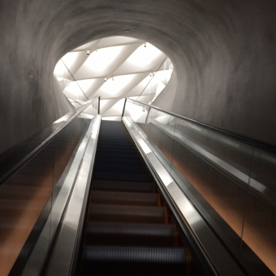"View of ""honeycomb"" ceiling while riding up the escalator"